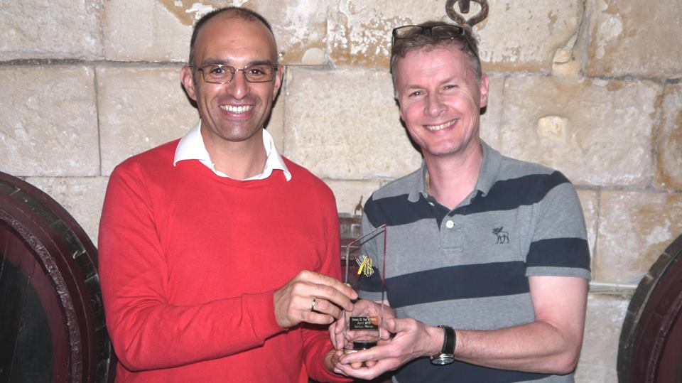 Malta Cricket Chairman Frank Spiteri receives a memento from Graces CC counterpart Johnathan Hardisty