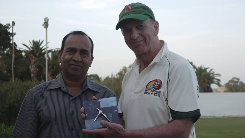 Marsa chairman Kevin Krishna presents Matthew Shore a commemorative Marsa Clock