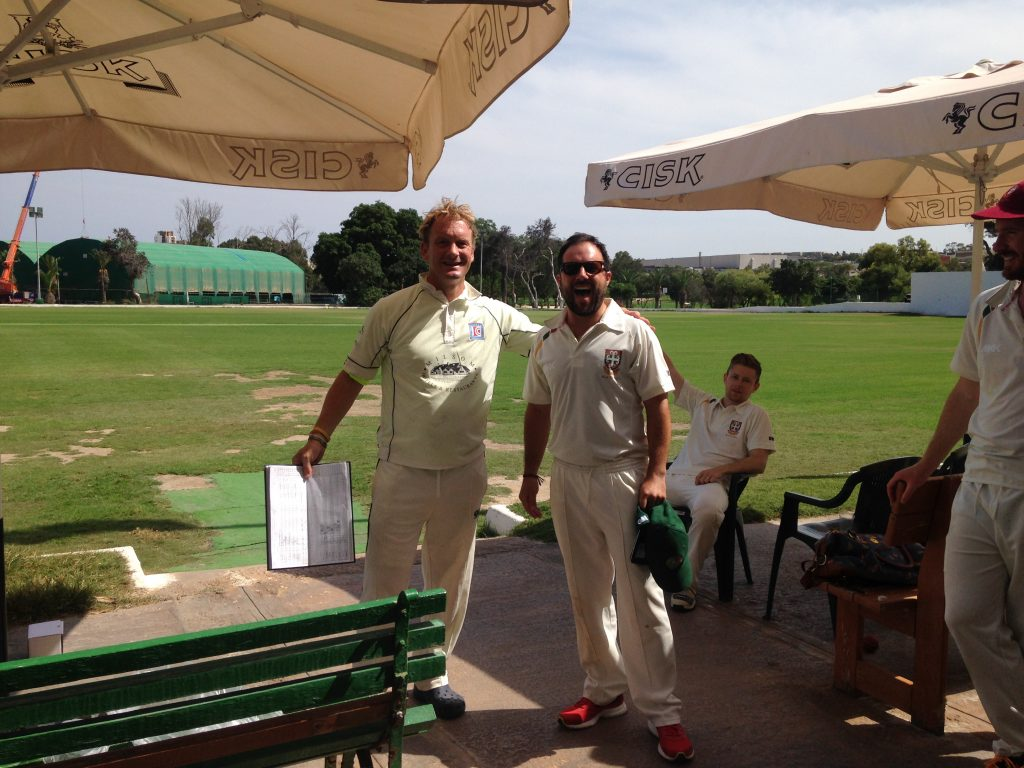 Marsa's Stephen Lucas with Player of the Match - Jamie Aitcheson (Downside Wanderers)